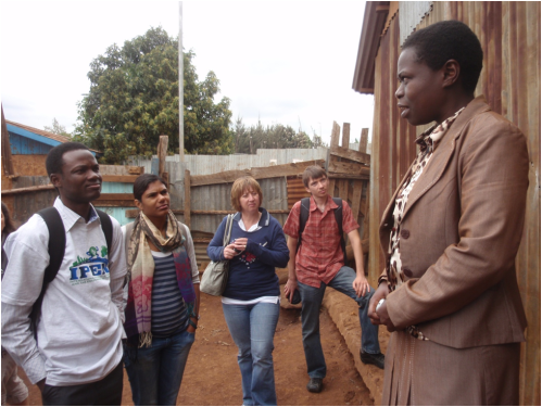 Conferring a community resident in the Kibera slum in Nairobi