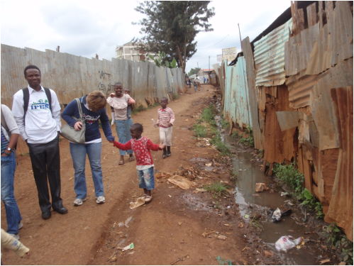 Adewale Oyeyemi and others meeting children in Kibera slum.