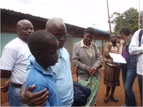 Vincent Onywere and others interviewing a boy about opportunities for play in Kibera.